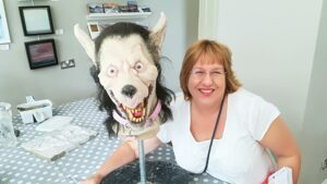 Image of Alyson Faye with fake werewolf head