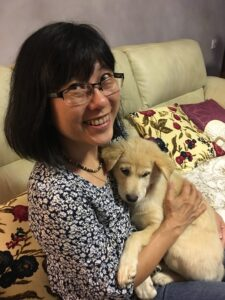 Image of Christina Yin with a puppy.